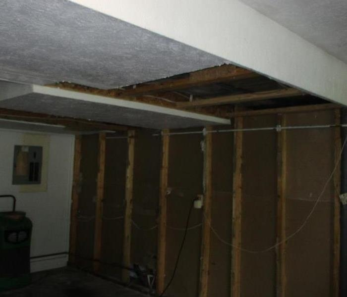 Wall and ceiling with drywall and insulation removed