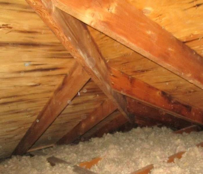 Attic ceiling with clean wood sheathing