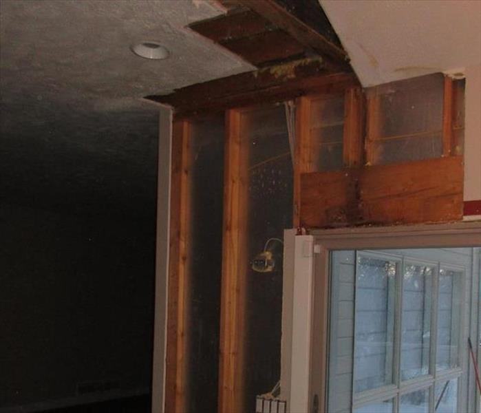ceiling and wall stripped down to wood studs with drying equipment