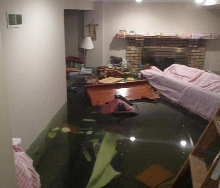 Basement with 2 feet of water and floating furniture