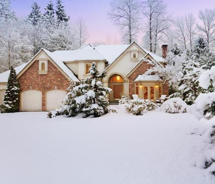 House in winter with snow and trees