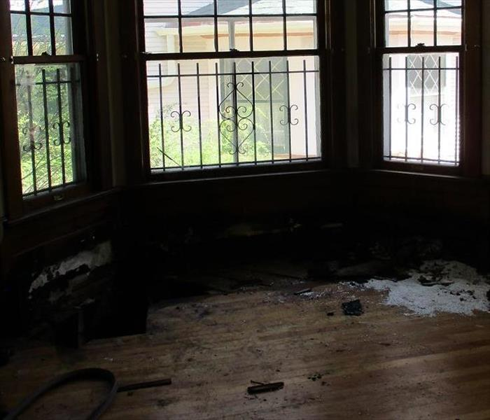 Living Room bay window with fire damage