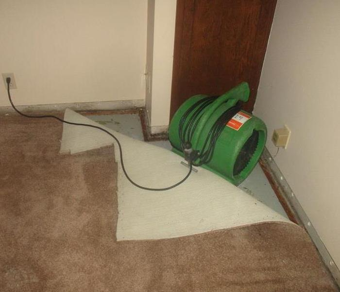Carpet clipped to air mover to float