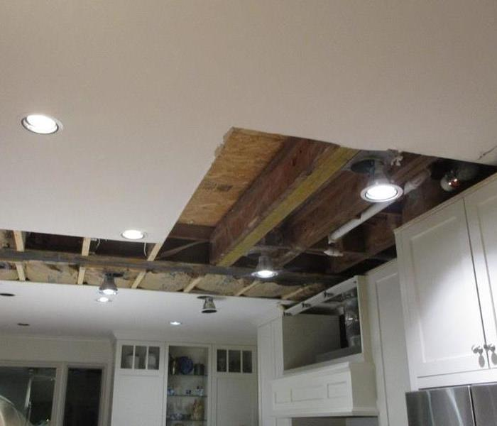 Kitchen with ceiling drywall removed
