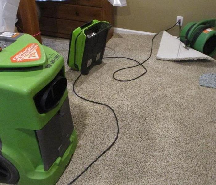 SERVPRO dehumidifier and air movers floating carpet to dry it